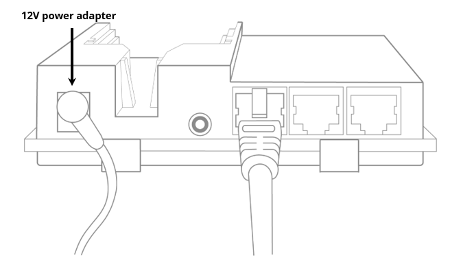 The communications module with a call out that shows where the 12V power adapter attaches to the module.
